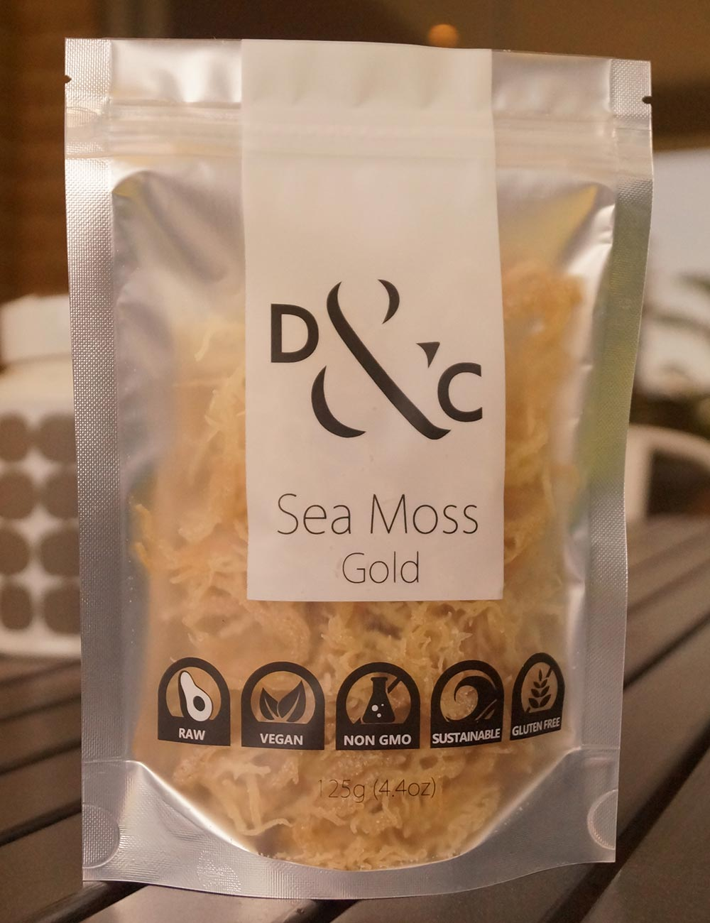dried-sea-moss-gold-detox-and-cure-125g-bag-of-dry-sea-moss-outdoor-timber-table